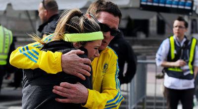 Reuters-Boston-Marathon-bombing-man-woman-embrace-photog-Jessica-Rinaldi